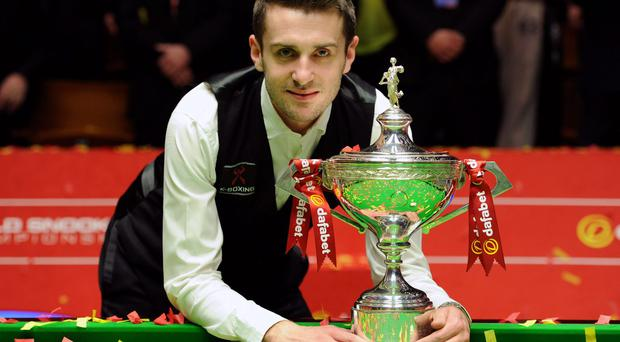 Mark Selby celebrating after winning the final of the Dafabet World Snooker Championships.