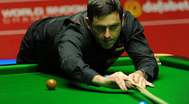 Ronnie O'Sullivan in action during the final session of the Dafabet World Snooker Championships at The Crucible, Sheffield