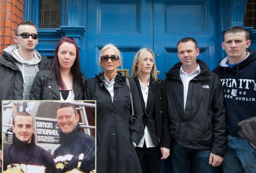 Family members Eoghan Murray, Fiona Murray, Mary Murray, Joanne Murray, Councillor John Brady (family friend) and David Murray at the inquest into the deaths of firefighters Mark O'Shaughnessy and Brian Murray (inset) yesterday.