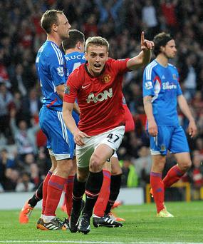 Manchester United's James Wilson celebrates after scoring his team's first goal during the Barclays Premier League match at Old Trafford on Wednesday. PA