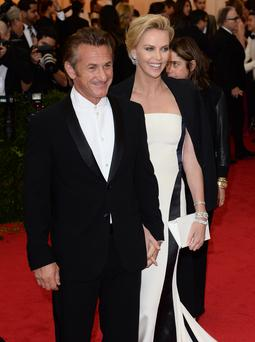 Sean Penn and Charlize Theron attend the