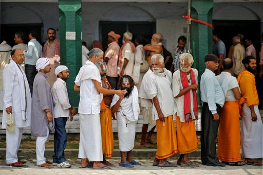 Voters line up to cast their votes at a polling station at Ayodhya in the northern Indian state of Uttar Pradesh. Around 815 million people have registered to vote in the world's biggest election. Reuters/Anindito Mukherjee