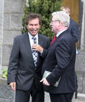 Former Minister for Justice Alan Shatter smiling with Tanaiste Eamon Gilmore at the annual 1916 Commemoration Ceremony in Arbour Hill today hours before his resignation. Pic:Mark Condren