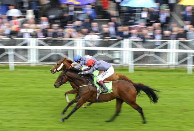 Ryan Moore riding Suegioo (L) win The Stanjames.com Chester Cup from Angel Gabrial at Chester racecourse in Chester, England. (Photo by Alan Crowhurst/Getty Images)