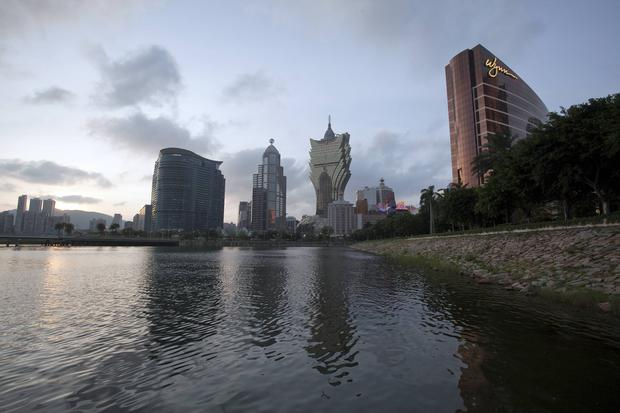 The Wynn Macau casino resort, owned by Wynn Resorts Ltd, right, and the Grand Lisboa casino, owned by SJM Holdings Ltd., center, stand in Macau, China