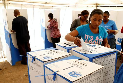 A woman casts her ballot in Johannesburg's Alexandra township. South Africans voted in the first