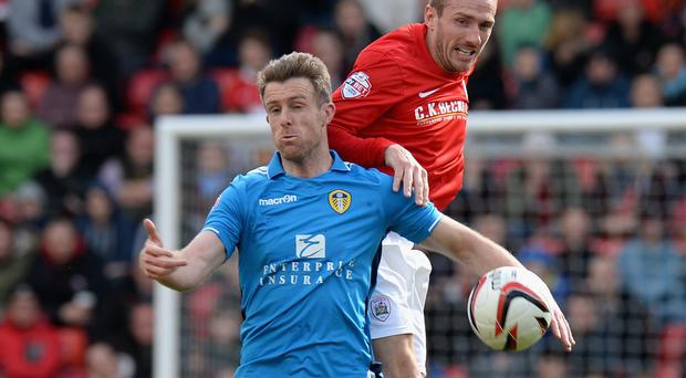 Liam Lawrence of Barnsley (right) tackles Michael Tonge of Leeds United during the Sky Bet Championship match between Barnsley and Leeds United at Oakwell (Photo by Tony Marshall/Getty Images)