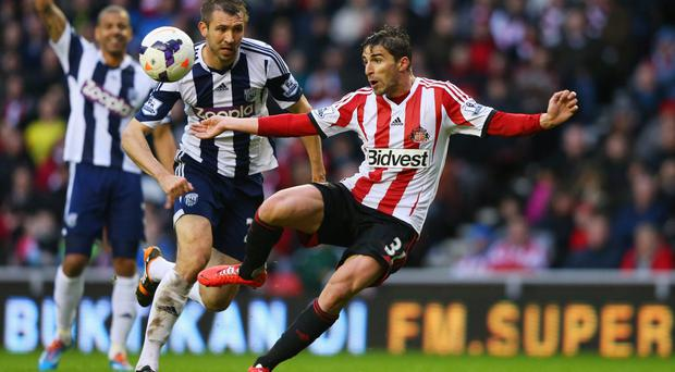 Fabio Borini of Sunderland (R) beats Gareth McAuley of West Bromwich Albion to score their second goal. (Photo by Alex Livesey/Getty Images)