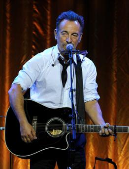 Musician Bruce Springsteen performs onstage during USC Shoah Foundation's 20th Anniversary Gala at the Hyatt Regency Century Plaza on May 7, 2014 in Century City, California. (Photo by Kevin Winter/Getty Images for USC Shoah Foundation)