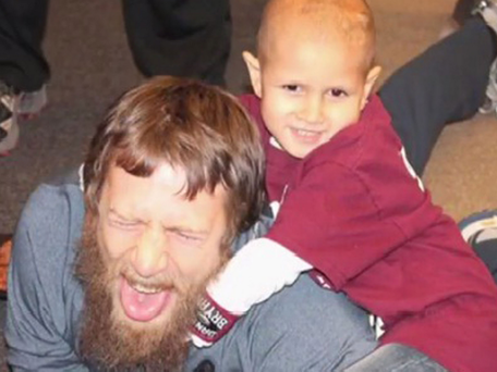 Young Connor (right) performs the Yes! Lock on his hero, the WWE Superstar, Daniel Bryan