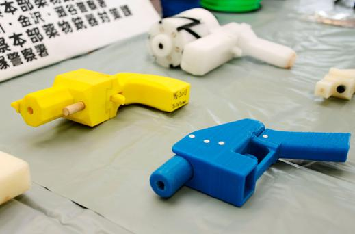 Seized plastic handguns which were created using 3D printing technology. Photo: Reuters/Kyodo