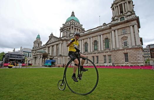 Cyclist Joff Summerfield, who circumnavigated the globe on a penny farthing, finishes his most grueling challenge yet at Belfast City Hall as he sets the pro riders a time to beat when he rides the Giro d'Italia time trial route on his penny farthing.