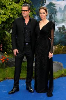 Brad Pitt and Angelina Jolie attending the premiere of Maleficent at Kensington Palace, London