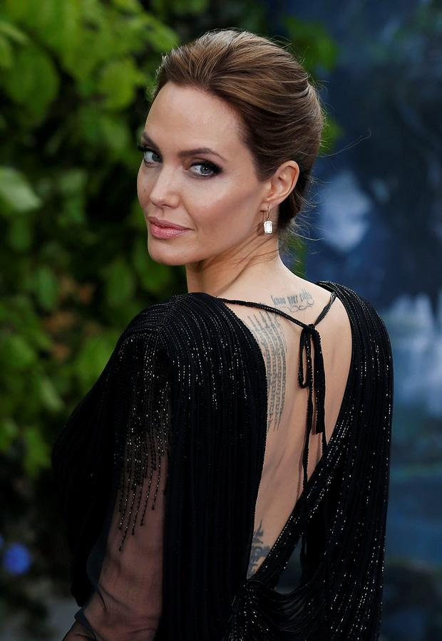 Angelina Jolie attending the premiere of Maleficent at Kensington Palace, London