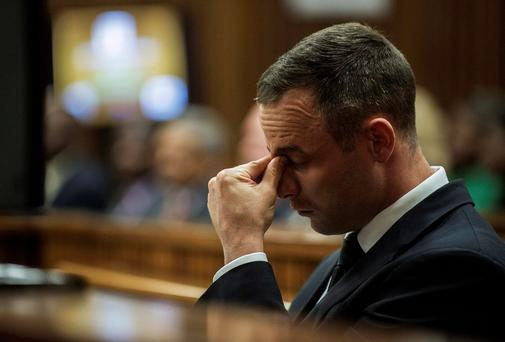 Oscar Pistorius sits in the dock at his murder trial yesterday. Photo: REUTERS/Gianluigi Guercia/Pool
