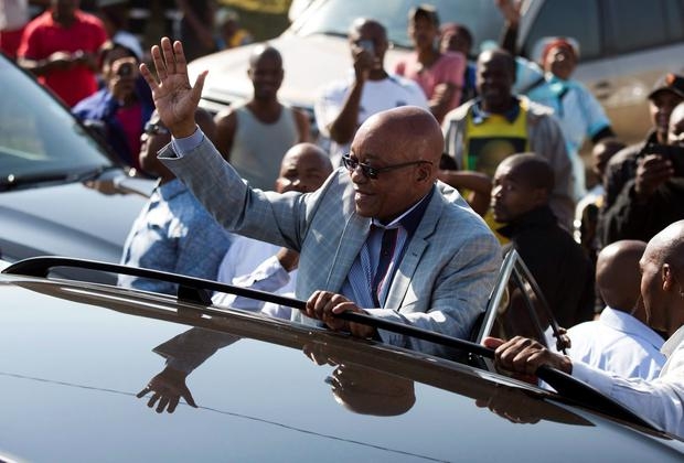South African President Jacob Zuma greets supporters of the ANC after voting. Photo: REUTERS/Rogan Ward