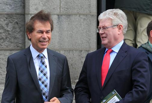 Less than three hours before the Taoiseach announced the resignation of Justice Minister Shatter, Eamon Gilmore was left to publicly defend Mr Shatter