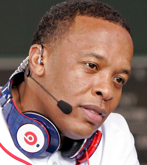 Recording artist Dr. Dre wears a pair of Beats headphones