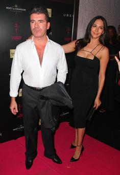 Simon Cowell and Lauren Silverman attending the London Cabaret Club VIP opening night at the Collection on May 8, 2014 in London, England. (Photo by Mark Robert Milan/GC Images)