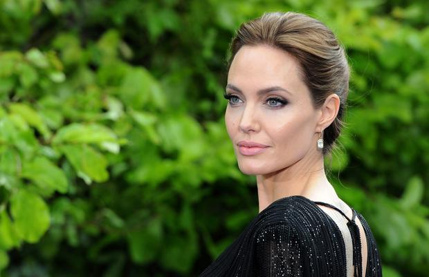 Angelina Jolie attends a private reception as costumes and props from Disney's