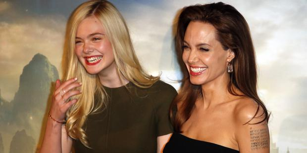 Elle Fanning (left) and Angelina Jolie (right) promoting their new movie Maleficent