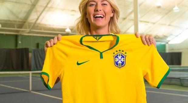 Maria Sharapova poses with her Brazilian jersey