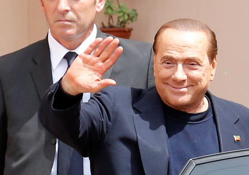 Silvio Berlusconi spent four hours inside a retirement home yesterday at the start of a 12-month community service sentence for tax fraud