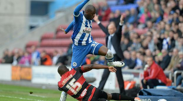 Wigan Athletic's Marc-Antoine Fortune battles for the ball with Queens Park Rangers Nedum Onuoha during the Sky Bet Championship Play-off, Semi Final match at the DW Stadium.