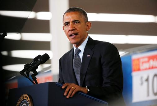 U.S. President Barack Obama speaks at a Walmart store on in Mountain View, California