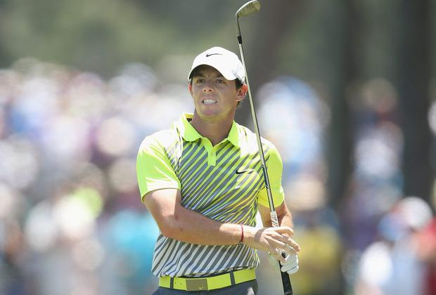 Rory McIlroy watches his shot to the first hole at the beginning of a front nine in which he dropped six shots