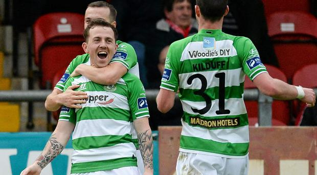 Gary McCabe celebrates with Shamrock Rovers team-mates Karl Sheppard and Ciaran Kilduff after scoring his side's first goal