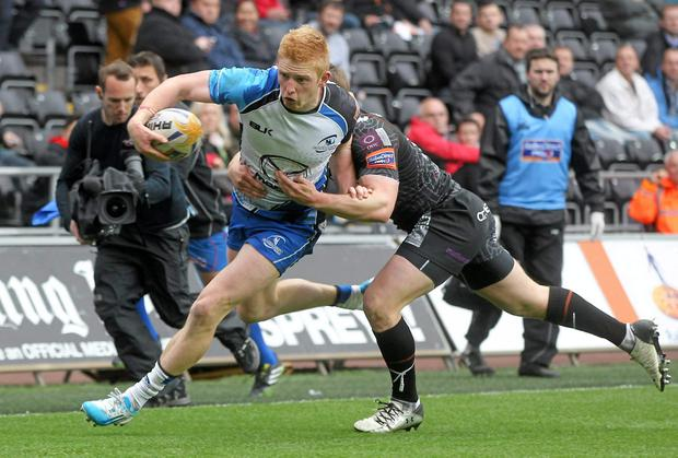 10 May 2014; Darragh Leader, Connacht, breaks through the defence of Jeff Hassler, Ospreys. Celtic League 2013/14, Round 22, Ospreys v Connacht, Liberty Stadium, Swansea, Wales. Picture credit: Steve Pope / SPORTSFILE