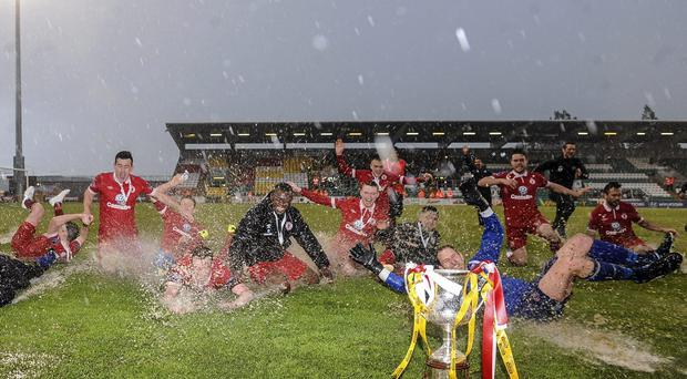 Sligo Rovers team celebrate with the cup after the game