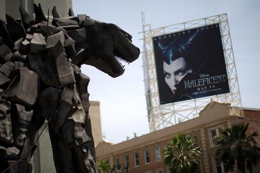 A statue of movie monster Godzilla stands in front of the TCL Chinese Theatre IMAX on Hollywood Boulevard in the Hollywood section of Los Angeles, California, May 9, 2014. The statue promotes the movie Godzilla IMAX 3D which opens on May 16. REUTERS/David McNew