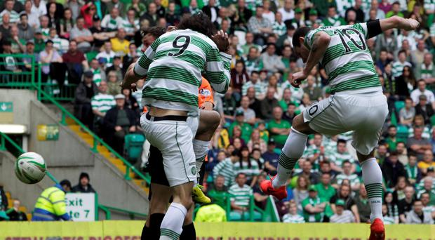 Celtic's Anthony Stokes scores against Dundee United at Celtic Park.