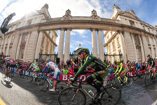 11 May 2014; Cyclists pass Goverment Buildings following stage 3 of the Giro d'Italia 2014 into Dublin. Armagh - Dublin. Picture credit: Stephen McCarthy / SPORTSFILE
