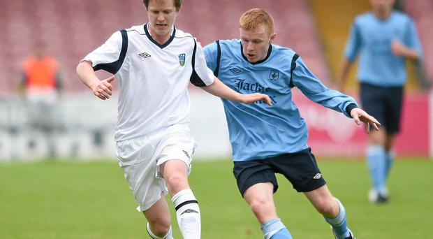 Timmy Molloy, UCD AFC, in action against Brian Murphy, Avondale United. FAI Umbro Intermediate Cup Final, Avondale United v UCD AFC, Turners Cross, Cork