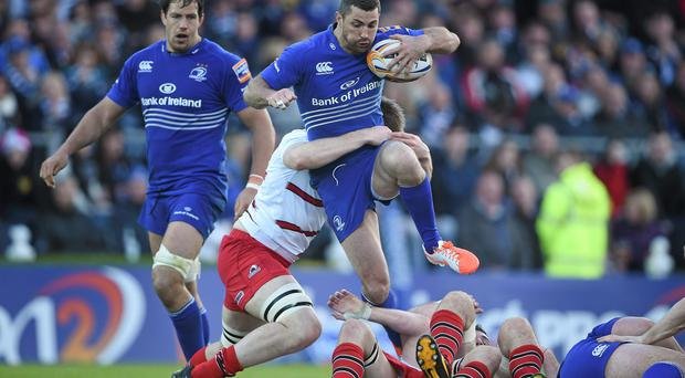 Rob Kearney, Leinster, jumps over a ruck as he is tackled by Alex Toolis, Edinburgh. Picture credit: Brendan Moran / SPORTSFILE