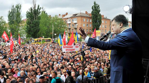 Ukrainian businessman, politician and presidential candidate Petro Poroshenko (R) meets with supporters in Nova Kakhovka in Kherson region, in southern Ukraine