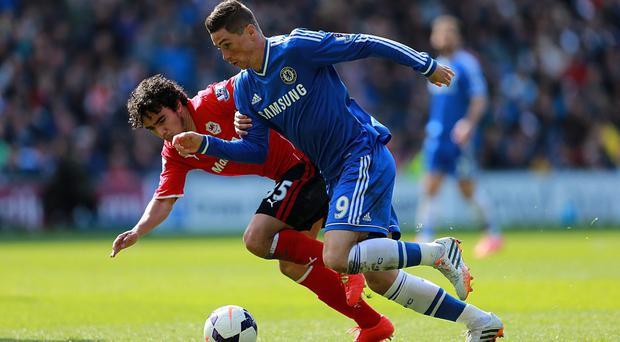 Chelsea's Fernando Torres (right) and Cardiff City's Fabio Da Silva (left) battle for the ball during the Barclays Premier League match at the Cardiff City Stadium, Cardiff
