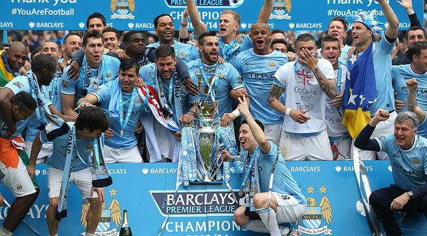 Manchester City's players celebrate winning the Barclays Premier League at the Etihad Stadium