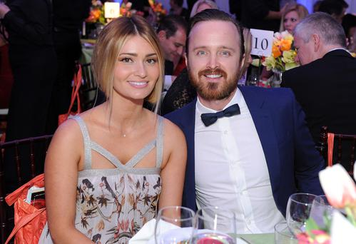 (L-R) Lauren Parsekian-Paul and her husband actor Aaron Paul