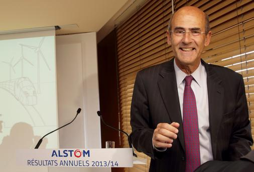 Alstom Chairman and Chief Executive Patrick Kron leaves the company's annual results presentation at the company headquarters in Levallois-Perret, near Paris