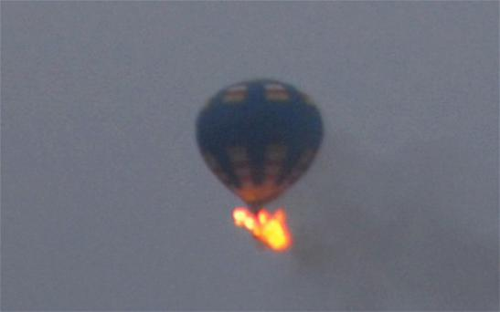 This photo provided shows what authorities say is a hot-air balloon that was believed to have caught fire and crashed in Virginia