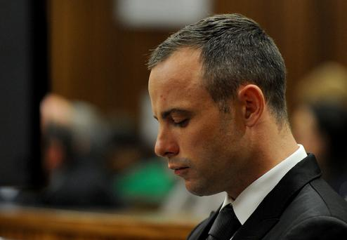 Oscar Pistorius in court for his ongoing murder trial in Pretoria, South Africa, Monday, May 12, 2014