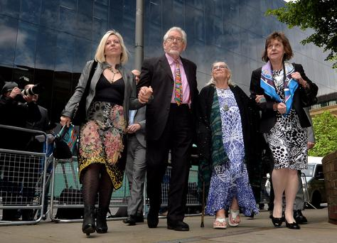 Veteran entertainer Rolf Harris arrives with daughter Bindi (left), wife Alwen and niece Jenny (right) at Southwark Crown Court, London where where he faces charges of alleged indecent assaults on under-age girls. PRESS ASSOCIATION Photo. Picture date: Monday May 12, 2014. The 84-year-old denies 12 counts of indecent assault between 1968 and 1986. See PA story COURTS Harris. Photo credit should read: Anthony Devlin/PA Wire
