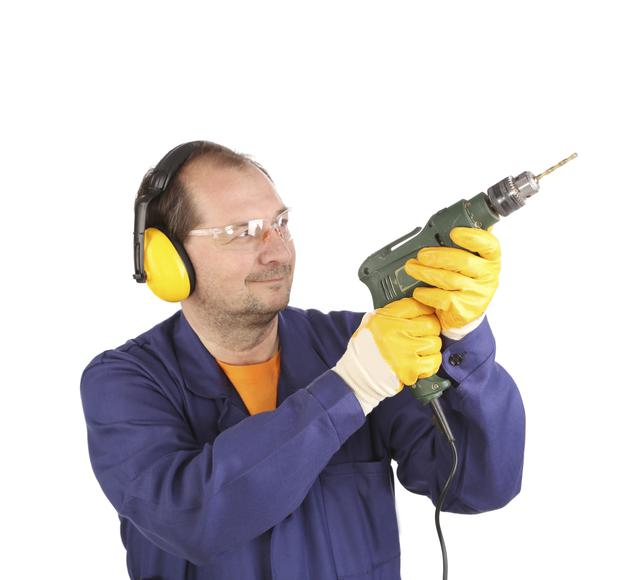 Attractive: A man with a drill