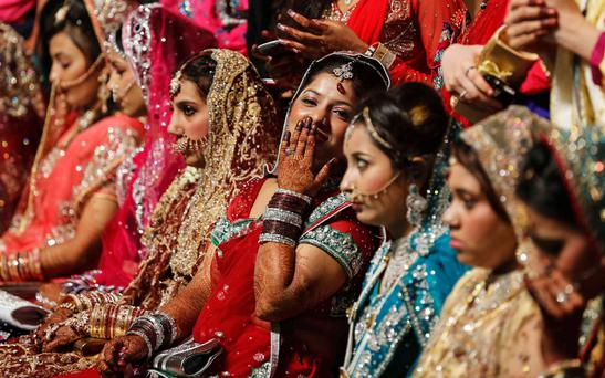 Muslim brides wait for the start of their mass marriage ceremony in Mumbai May 11, 2014. A total of 35 Muslim couples took wedding vows during the mass marriage ceremony organised by a Muslim voluntary organisation, organisers said. REUTERS/Danish Siddiqui (INDIA - Tags: SOCIETY RELIGION)