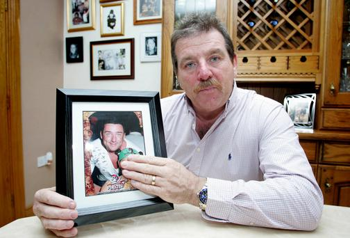 Stephen Collins with a picture of his son Roy. Picture. Emma Jervis/ Press 22
