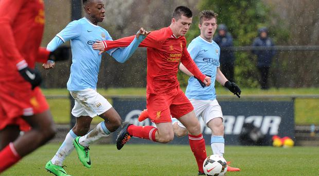 Alex O'Hanlon of Liverpool and Denziel Boadu of Manchester City in action during the Barclays Premier League Under 18 fixture between Liverpool and Manchester City at the Liverpool FC Academy on March 22 in Kirkby, England. (Photo by Nick Taylor/Liverpool FC via Getty Images)